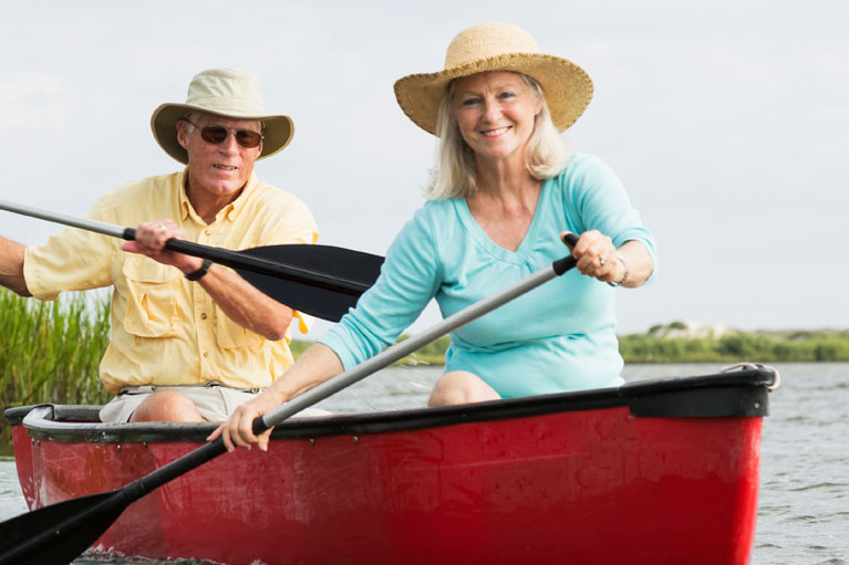 Elderly couple canoeing