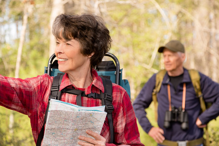 Elderly woman navigating while on a hike